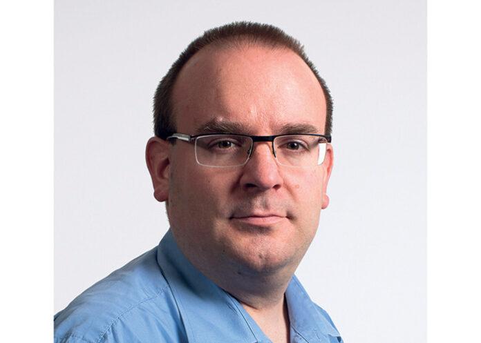 David Papin, responsable informatique et moyens généraux chez Polyexpert Île-de-France.